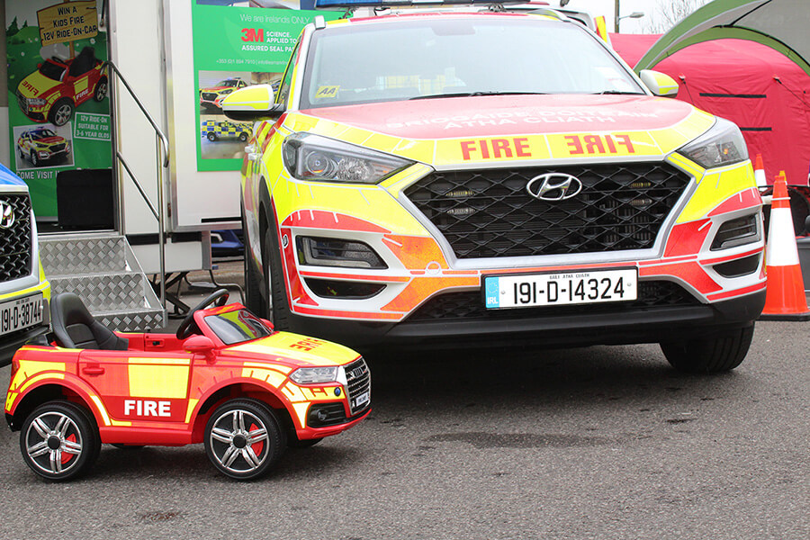 Fire officer stand little car